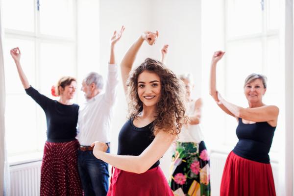 People in dancing class with dance teacher