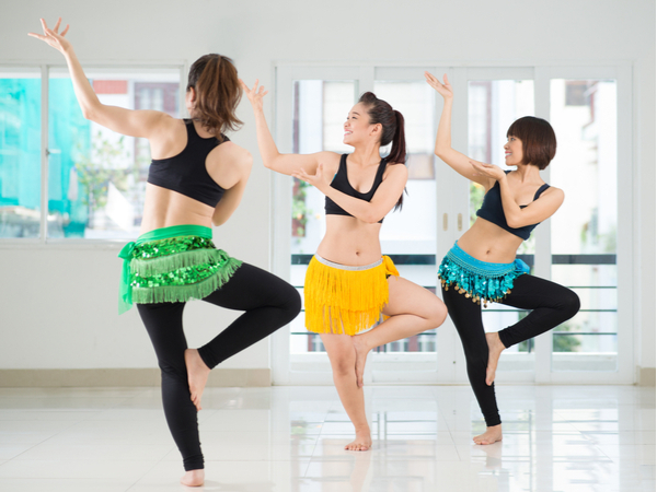 Image of beauty belly dancers performing in the dance studio