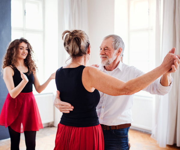 Senior Couple dancing With Ballroom Dance Instructor