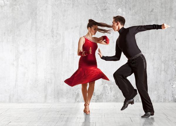 Ballrooms pair enjoys dancing in a room