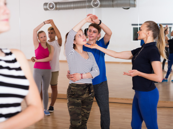 Female Choreographer Teaches Teens To Dance In The Dance Studio