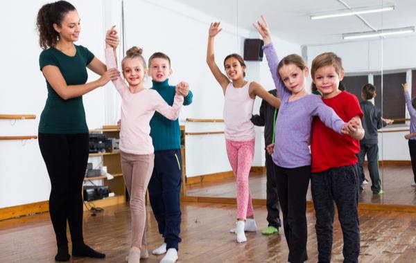 DXS - Group Of Kids In Ballroom Dance Class