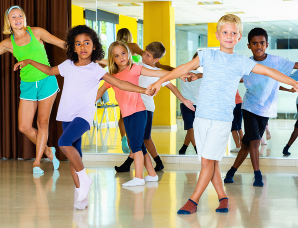 Children having their dance lesson with female instructor