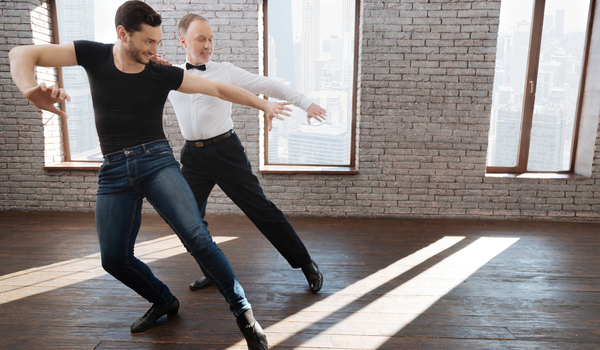 Passionate Ballroom Dance Instructor teaching his student