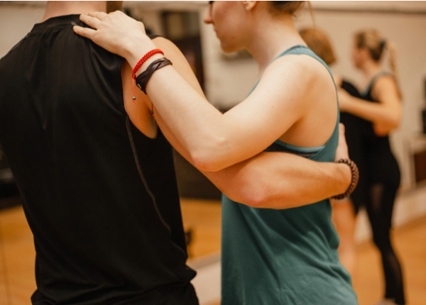 Young Male And Female Taking Dance Class