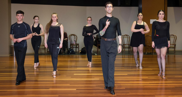 A Group Of Dancers Teaching By